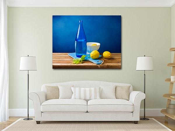 Bottle and Lemon Artwork on the Wall