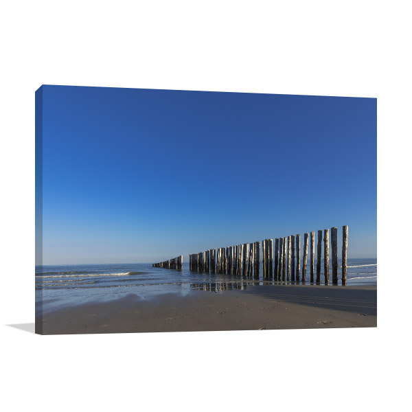 Piles At A Lonesome Beach Canvas Art