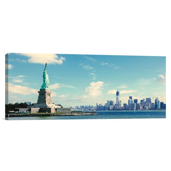 Statue And Manhattan Canvas Art Print