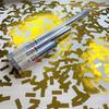 Gold confetti cannon for sparkling anniversary celebrations