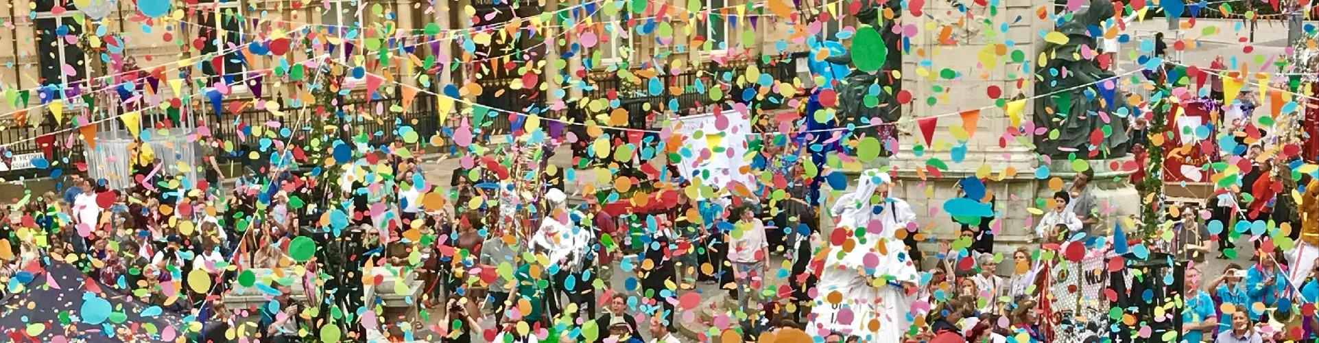 multicolour confetti circles fill town square