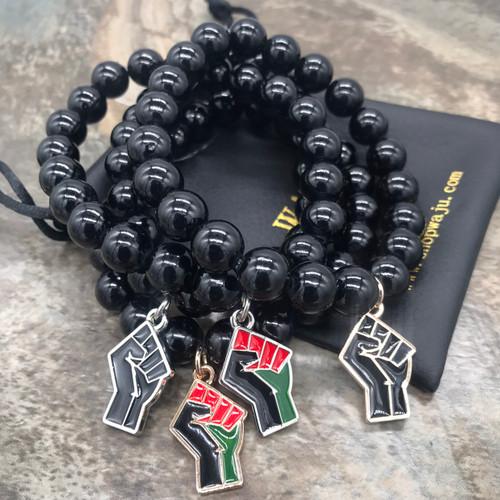Black jade bracelet with Fist charm