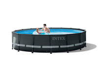Enhance your backyard this summer with the Intex Ultra XTR™ Frame pool that features beautiful blue tile print and elegant graphite exterior.