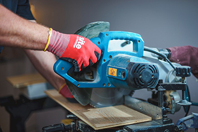 Carpenter cutting timber with a power saw|SafetyDocs