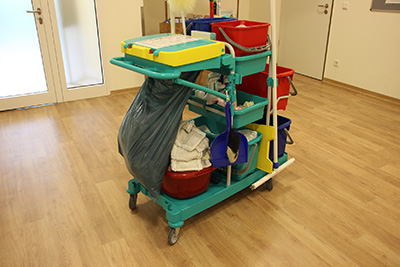 Commercial cleaning trolley with cleaning tools at workplace|SafetyDocs