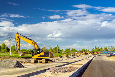 Excavator being used on new road being built
