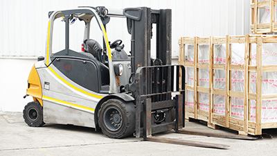 A forklift moving a pallet of goods