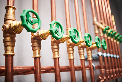 new plumbing installation showing copper pipes and plumbing fittings