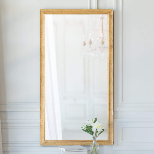 Eloquence® Filipe Mirror in Gold Leaf Finish with Flowers and Books. Text: New Design in Stock.