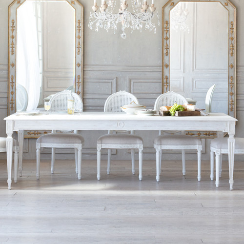 Eloquence® Grande Gustavian Dining Table in Pickled White Finish in French Style Dining Room with Mirrors, Chandelier, and Dining Chairs