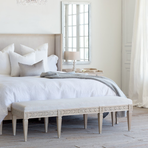 Eloquence® King Anais Bench in Storm Linen and Nordic Oak Finish at the Foot of a Cassia Bed