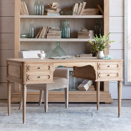 Eloquence® Coco Madame Desk in Bleached Oak Finish in Office with Bookcase, Chair, Decorative Books and Jars 3/4 Angle