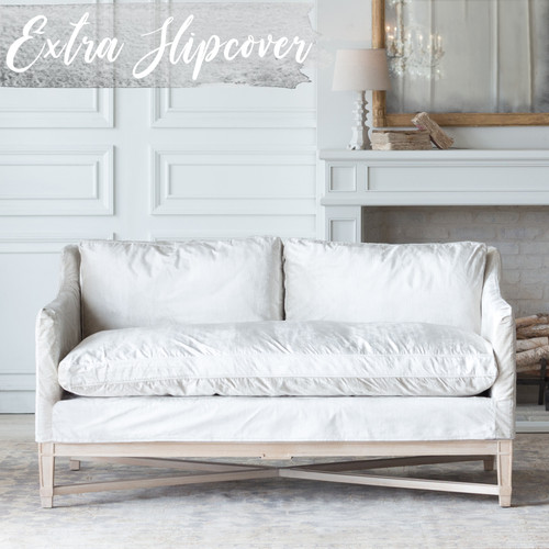 Eloquence® Extra Slipcover in Dove Velvet for Scandinavian Loveseat Front View. Text: Extra Slipcover in Stock