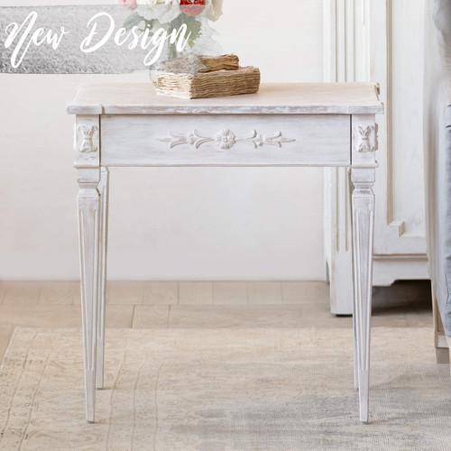 Eloquence® Zinnia Side Table in White Mist Finish Thumbnail. Text: New Design