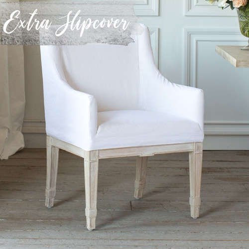 Eloquence® Extra Slipcover in Whispy White Linen for Scandinavian Dining Chair 3/4 Angle. Text: Extra Slipcover