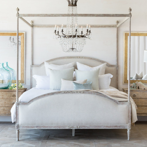 Eloquence® Dauphine Canopy Antique Reproduction Bed in Fog Linen and Beach House Natural Finish in a French Style Bedroom with Scandinavian Bergere.