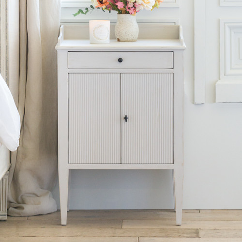 Eloquence® St. Lucia Nightstand in Grain Sack Finish with a Double-Door Cabinet and Single Drawer in a French Style Bedroom
