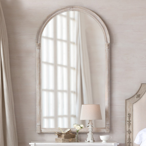 Eloquence® Renaissance Mirror in Lime-Washed Oak Finish Hanging Above a Side Table with a Lamp and Decorative Objects Close View