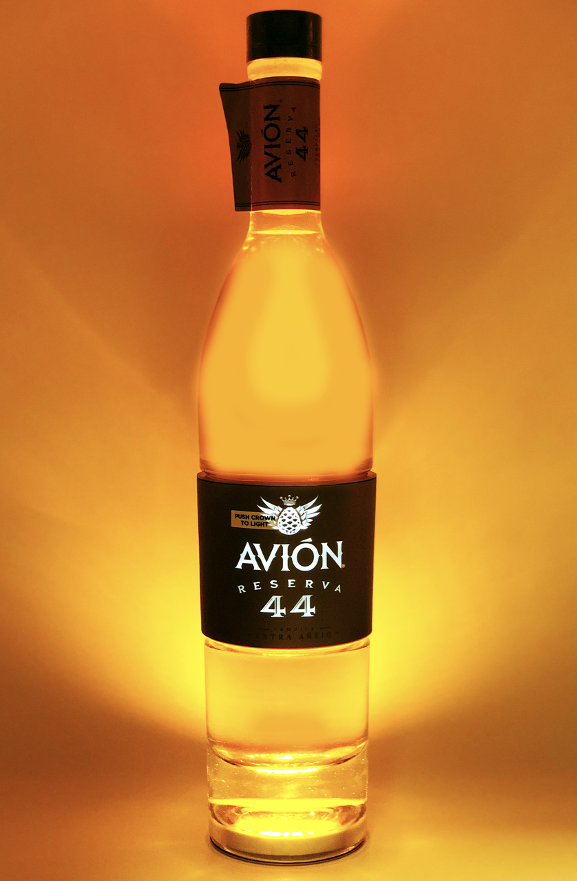 d75e3f91f91 Avion Reserva 44 Extra Anejo Luminous Edition Tequila with lights turned on.