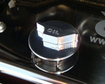 Oil filler cap with raised oil can logo