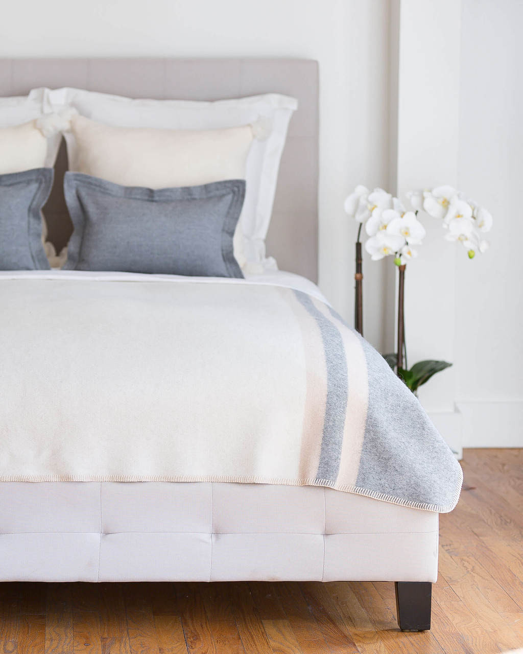 Ivory, taupe and blue multicolor Alicia Adams Alpaca Field Blanket in room setting ecofriendly recycled alpaca and wool handstitched blanket, famous designer, today show alpaca blanket, alicia adams today show