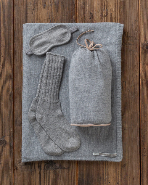 Alicia Adams Alpaca Globetrotter Travel Blanket Set, alpaca socks, alpaca travel blanket, travel kit with blanket and eyemask, light grey and tan plane travel set
