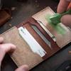 Knafs Leather Strop Wallet Black (KNAFS-00017) applying strop compound