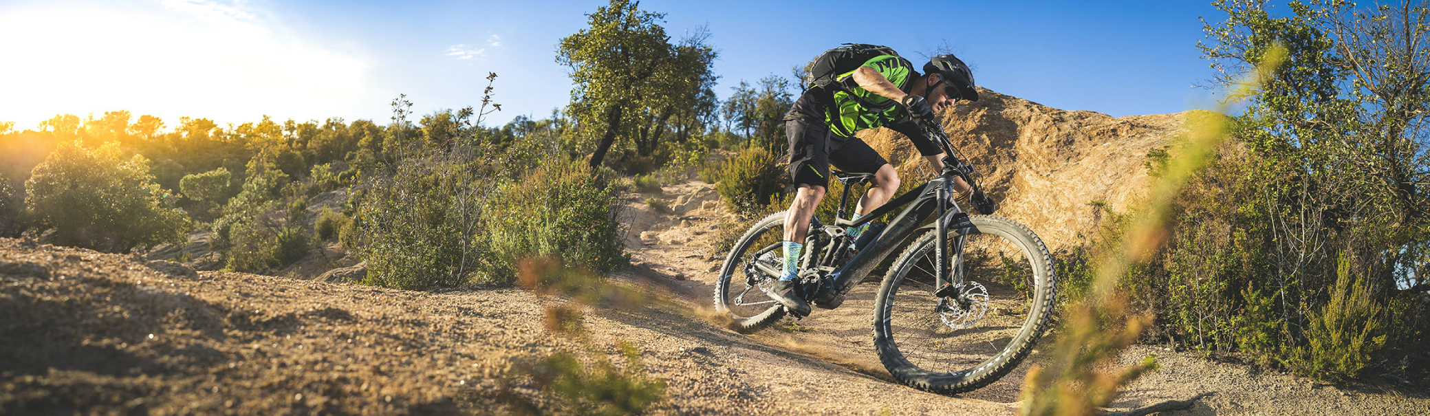 Mountainbiker going downhill on his Merida's bike