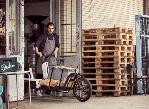 Shopkeeper using a Bergamont Cargo Bike