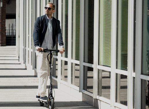 Man on his Walberg electric Scooter