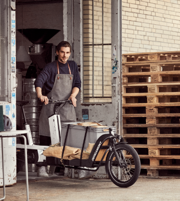 Shopkeeper loading his cargo electric bike for a delivery