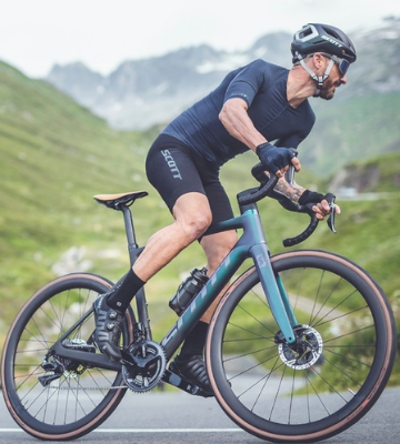 Man on a mountain road cycling his Scott's road electric bike