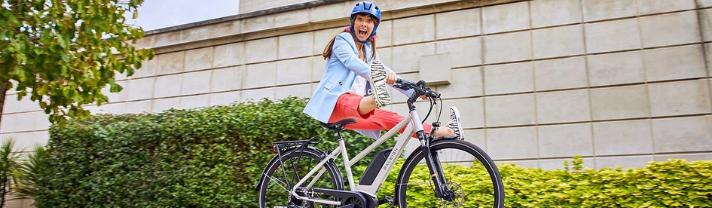Woman having fun on her Raleigh electric bike