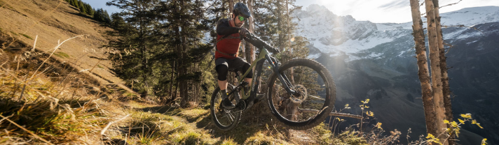 Man jumping an obstacle on his Scott eMTB
