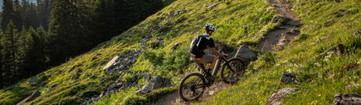 Man going uphill with ease thanks to his Scott's ebike