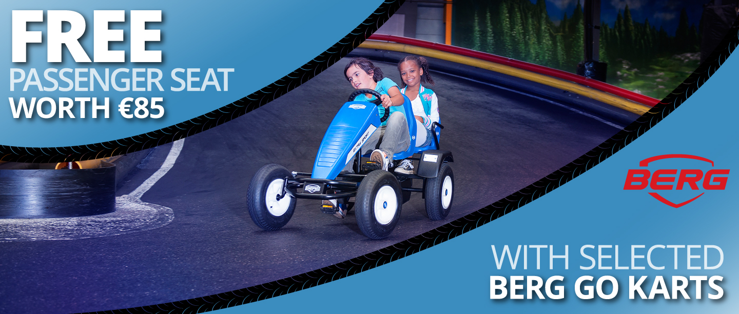 Kids playing together on a Berg go kart on a track thanks to the free passenger seat offer