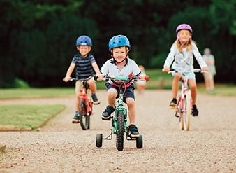 children cycling raleigh bikes