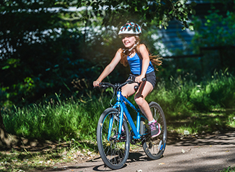 Girl riding her Ridgeback bike with a big smile on her face