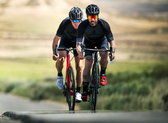 2 men on their Merida road bikes