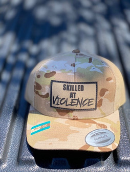SKILLED AT VIOLENCE TRUCKER HAT (Multicam Arid)