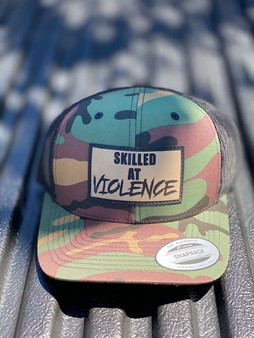 SKILLED AT VIOLENCE TRUCKER HAT (M81 Woodland)