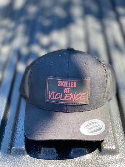 SKILLED AT VIOLENCE TRUCKER HAT (Black/Black Mesh)