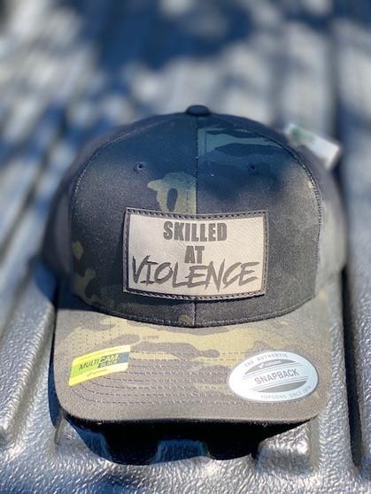 SKILLED AT VIOLENCE TRUCKER HAT (Multicam Black)