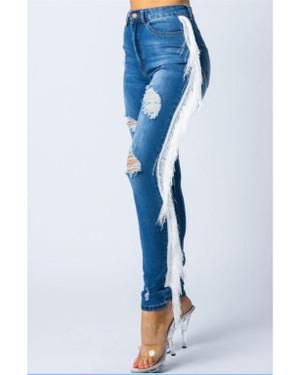 Distressed Medium Wash Denim Jeans with a Fringe Side Seam Finish.