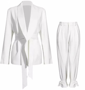 The Suit: Jacket with Long Lapels and Feed Through Self Tie Belt; Trousers with Front Zip/Button, Side Pockets and Ankle Ties in White.