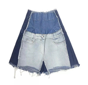 High Waist Flare Shorts with Button and Zip Front Closures, Front and Back Pockets in a Patchwork Frayed Denim Relaxed Fit 100% Cotton
