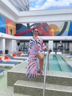 Caftan Short Set in a Multicolored Abstract Print: One Size Fit Most OSFM Caftan - Three Button Closure, Front Spilt, Floor Length, Butterfly Sleeves Polyester and Mesh Blend Shorts - Banded Elastic Waist, Side Pockets, Mid Thigh Length Polyester and Lycra Blend