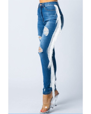 Distressed Medium Wash Denim Jeans with a Fringe Side Seam Finish.