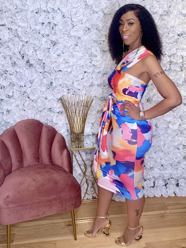 Two Piece Set with Multiway Convertible Top and Midi Skirt with  at Waistline in a Multicolored Paint Splash Print. 95% Polyester 5% Elastane