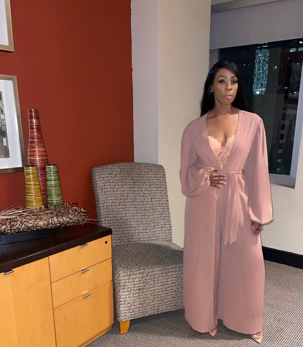 Two Piece Set in Light Weight Semi Crinkle Fabric in Blush:  Long Cardigan with Puffy Sleeves   Wide Leg Trousers with  Elastic Waistline, Self Tie Belt and Side Pockets.